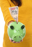 Female holding a piggy bank Royalty Free Stock Images