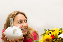 Female holding piggy bank. In her hands Royalty Free Stock Photo