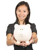 Female holding piggy bank Royalty Free Stock Photos