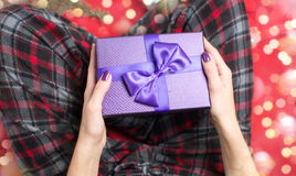 Female holding a purple gift box Royalty Free Stock Images