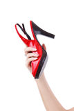 Female holding red shoe Stock Photo