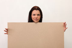 Female holding sign or board Royalty Free Stock Images