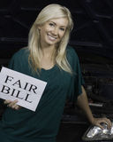 Woman holding sign in garage Stock Photos