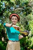 Female holding snake with blurred green background Stock Photo