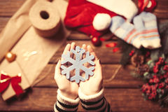 Female holding snowflake toy Royalty Free Stock Images