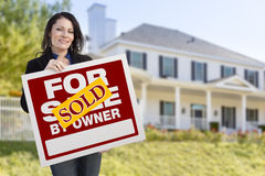 Female Holding Sold By Owner Sign In Front of House Royalty Free Stock Photography