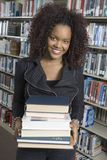 Female Holding Stack Of Books Stock Photography
