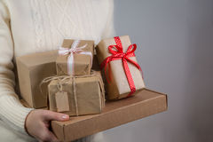 Female holding stack of christmas presents. Christmas concept royalty free stock photography
