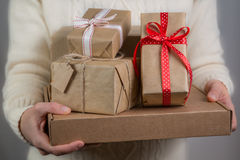 Female holding stack of christmas presents. Christmas concept Stock Image