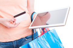 Female holding tablet and card as online shopping banking concep Royalty Free Stock Image