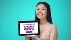 Female holding tablet with learn british english application, ready to start. Stock footage stock video
