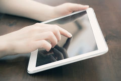 Female Holding And Touching A Blank White Business Tablet On A Desk Stock Photo