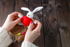 Female holding toy bunny with red heart Stock Photo