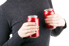 Female holding two closed cans of soda. Woman holding two cans of soda Stock Photography