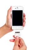 Female holding USB port charger connect to smart phone. Royalty Free Stock Photo