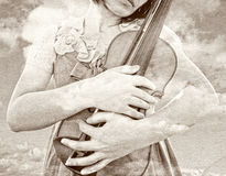 Female holding violin vintage look Royalty Free Stock Image