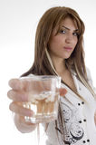 Female holding wine glass Stock Photo