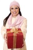 Female holding wrapped present. Royalty Free Stock Photography