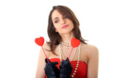 Female holds two small hearts, isolated on white Stock Image