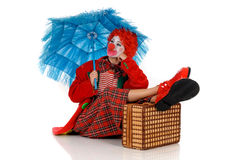 Female holiday clown. Colorful dressed female holiday clown, happy joyful expression on face. Studio shot Stock Images