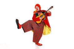 Female holiday clown. Colorful dressed female holiday clown, happy joyful expression on face. Studio shot Royalty Free Stock Image