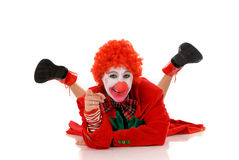 Female holiday clown. Colorful dressed female holiday clown, happy joyful expression on face. Studio shot Stock Photos
