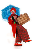 Female holiday clown. Colorful dressed female holiday clown, happy joyful expression on face. Studio shot Stock Photo