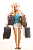 Female holidaymaker with bags Stock Photo