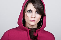 Female Hoodie against Grey Background Royalty Free Stock Images