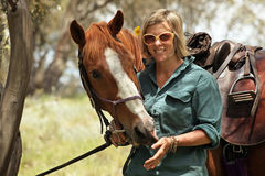 Female horse rider. Female rider with horse in the outback Stock Images