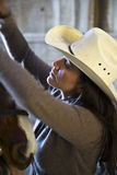 Female horse wrangler. Stock Images
