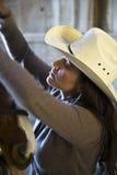 Female horse wrangler. Stock Images