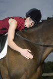 Female Horseback Rider Hugging Horse Stock Photos
