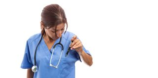 Female hospital nurse getting ready for work royalty free stock photography