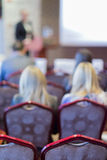 Female Host Speaker Speaking in Front of the Audience During Conference Stock Image