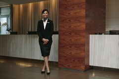 Free Female Hotel Receptionist At Workplace Royalty Free Stock Photos - 114544048