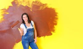 Female house painter with a paint roller royalty free stock photography