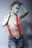 Female House Painter Splattered with Latex Paint Stock Images