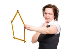 Female with house shape measure, hard decision Stock Photography