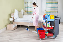 Female Housekeeper Mopping Floor Stock Photo