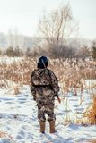 Female hunter in camouflage clothes ready to hunt, holding gun a. Nd walking in forest. hunting and people concept stock photos