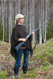 Female hunter with gun in the forest Royalty Free Stock Photos