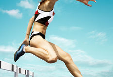 Female hurdle runner Royalty Free Stock Image