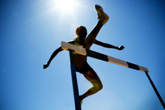 Female hurdler in action Royalty Free Stock Images