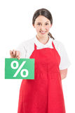 Female hypermarket worker holding sale or discount sign Royalty Free Stock Photo