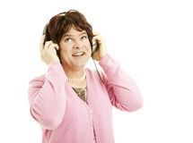 Female Impersonator with Headphones Stock Photo