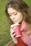 Female In A Park Drinking Coffee Royalty Free Stock Photo