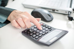 Female index finger typing on a calculator Royalty Free Stock Photos
