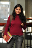 Female Indian Student Holding Cellphone Stock Photo