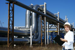 Female inpector performing an audit of tank farm Royalty Free Stock Photography